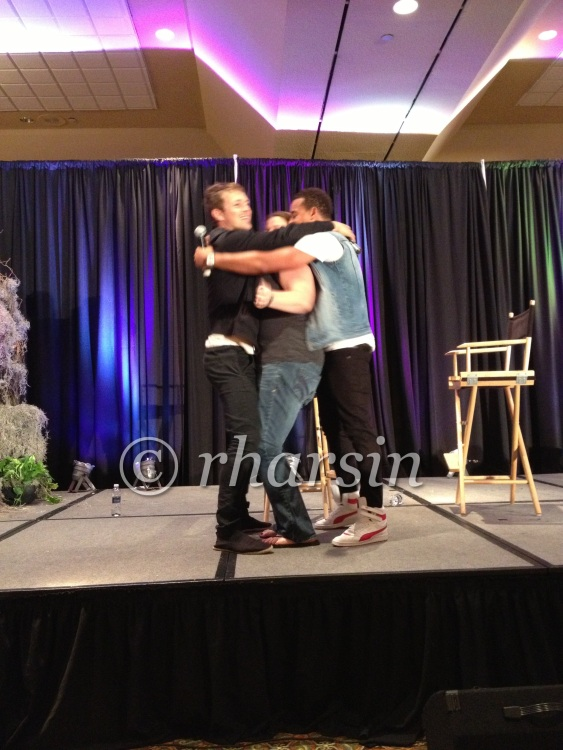 Charlie and Robert hugging/sandwiching a very lucky fan. (source: @rharsin)